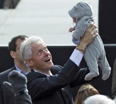 Bill Clinton smiles at baby