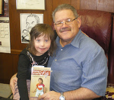 Chloe reads to PA Senator Tim Solobay