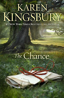 cover of The Chance by Karen Kingsbury shows a small bundle of letters tied with a red ribbon laying at the foot of a tree