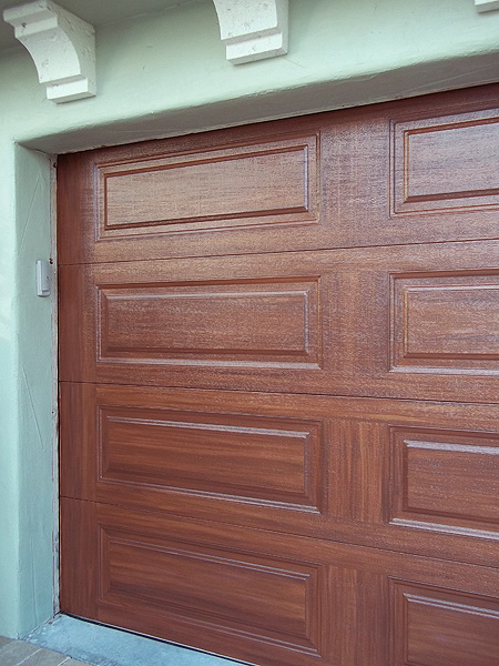 Nice job on garage door everything i create paint for Wood looking garage doors