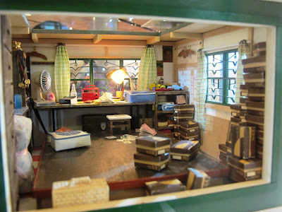 Interior of the upstairs office of a miniature model of a Hong Kong shoe shop from the 1960s.
