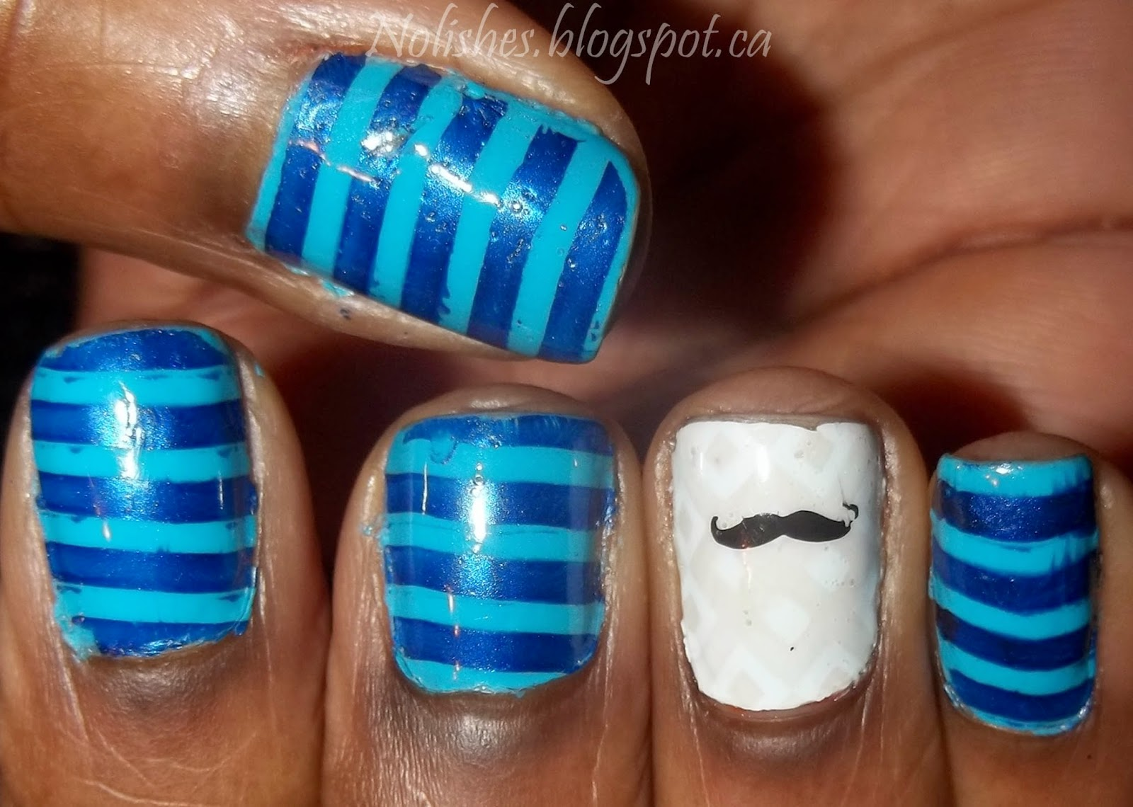 Blue Striped Movember Manicure using Essie 'I'm Addicted', and China Glaze polishes 'Scandalous Shenanigans', 'New Birth', and 'Five Rules'. Stamped with Moyou London Pro XL plates 01, and 08