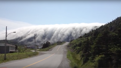 A massive formation of fog rolling down the mountain