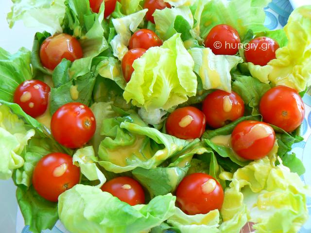 Salad with cherry tomatoes and sauce vinaigrette