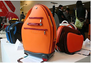 http://www.forbestraveler.com/gadgets-gear/high-fashion-luggage-slide-1.html?thisSpeed=20000