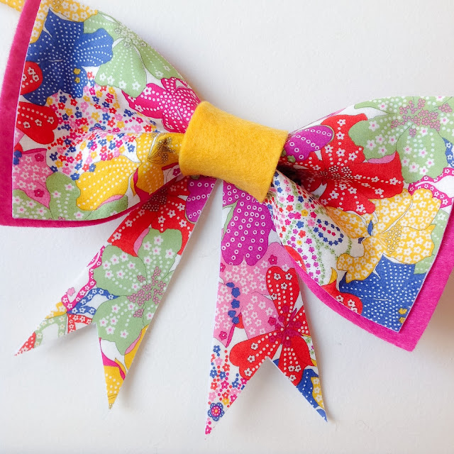 Close-up Bright Colourful Liberty Print Mauvey Bow Garland Bunting Girls Wall Hanging