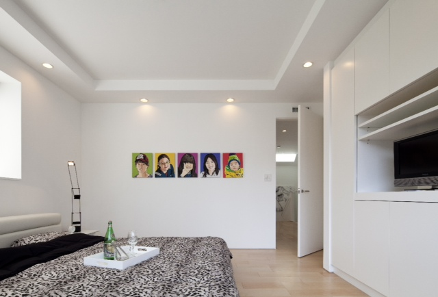 Small bedroom with white walls