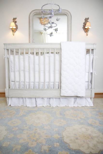 Baby crib, bird mobile, sconces, mirror, Restoration Hardware; Nursery in the Nest; Nora's Nest