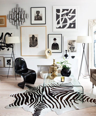 Fancy  Glam Gallery Wall Black u White photographs u art prints stand out against the crisp white wall The zebra rug really ties everything together and adds a