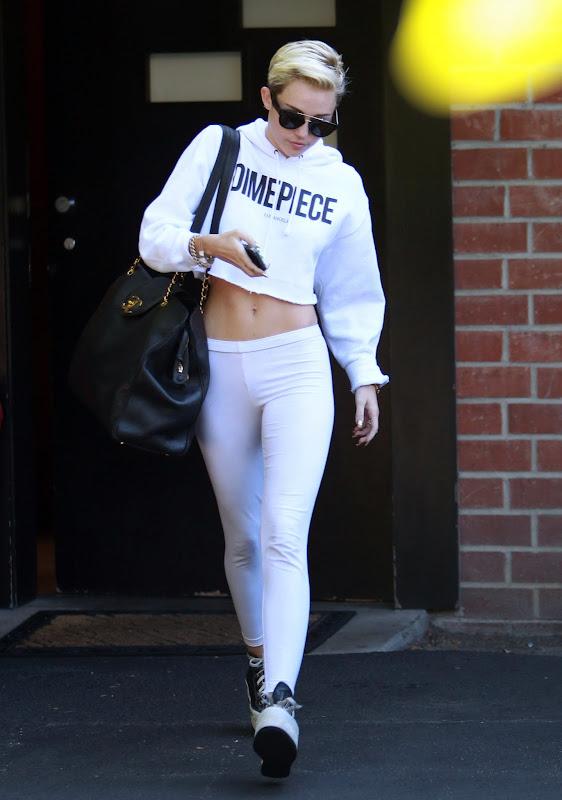 Miley Cyrus hot in white leggings