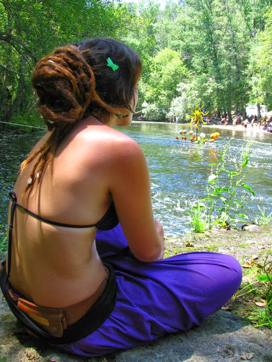 rastafari girl in bikini seat near the river