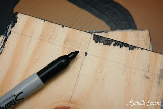 permanent marker dot on wood