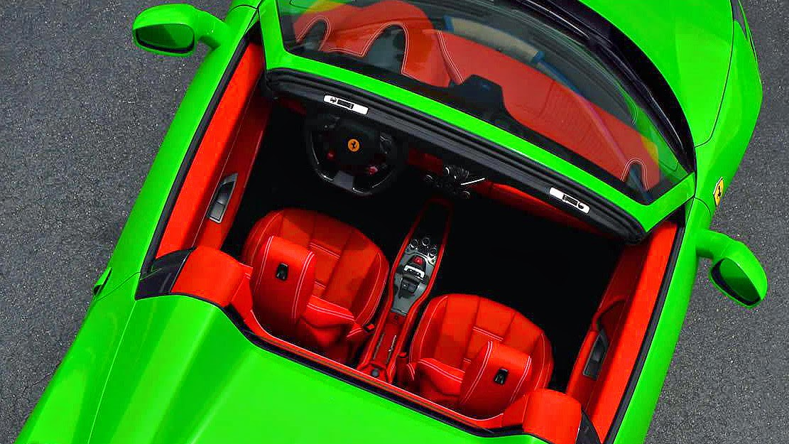 its not for the faint hearted especially with the contrasting red leather interior that pops out like a glowing red nose on a snowy night with the top - Ferrari 458 Spider Green