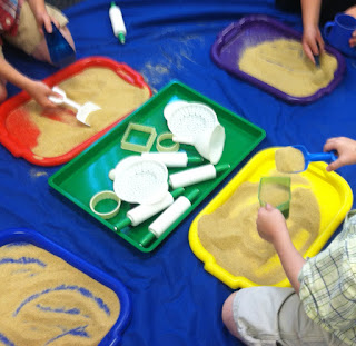 sand on trays for preschool (Brick by Brick)