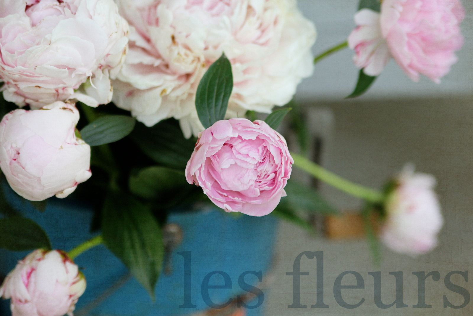 Using your vintage ice cream maker as a vase for peonies