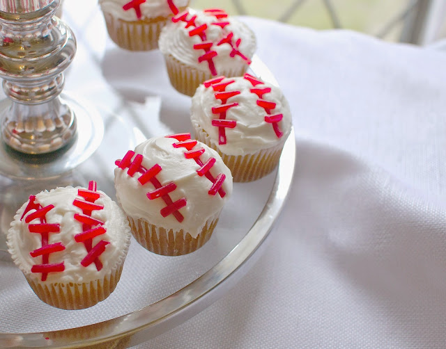 DIY Baseball themed baby shower for a sweet little boy and mom to be! Party includes authentic baseball decor, tassel banner, game day themed food, and DIY baseball cupcakes.