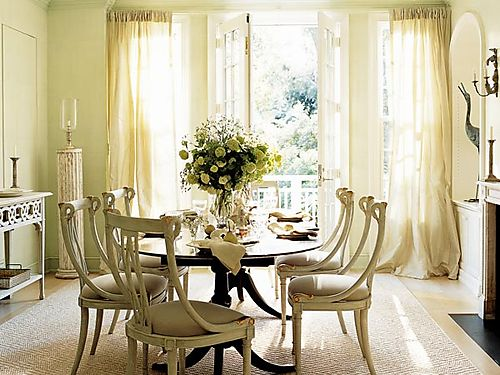 The Dark Oval Dining Table Adds A Beautiful Contrast To Lighter