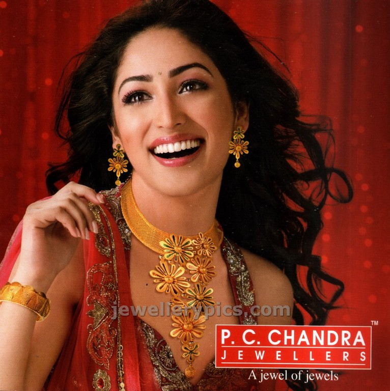 Yami Gautam in gold designer choker by PC chandra - Latest ...