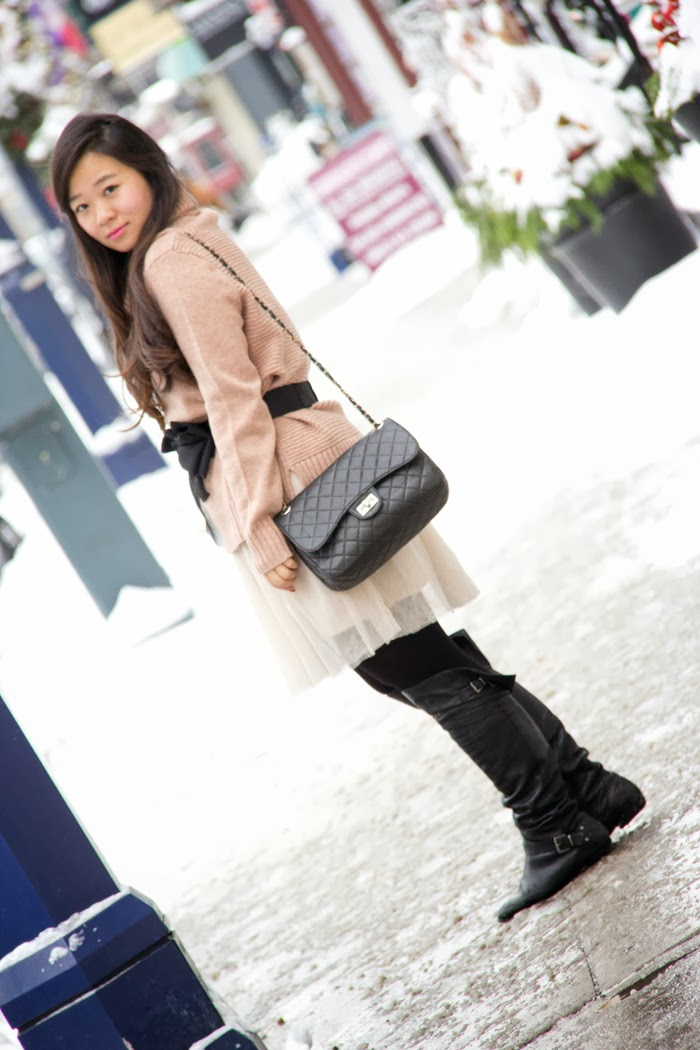 winter-outfits, Cream-comfy-sweater, channel-inspired-purse, black-boots