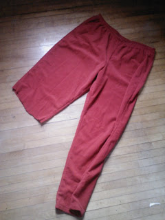 Red pants with one leg cut off at the knee.