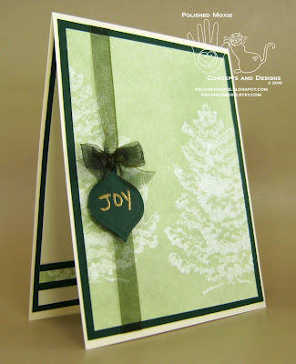 Picture of my green snowy trees Christmas card set at a right angle to show its dimensional elements.