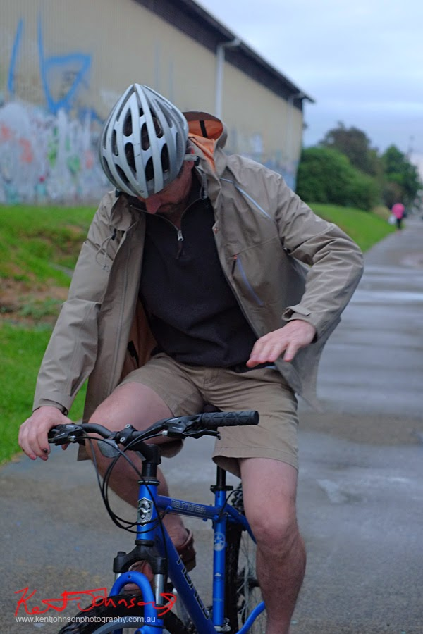 Jacket open, riding bike, Levi's Modular Commuter Parka. Photo by vivalaViv