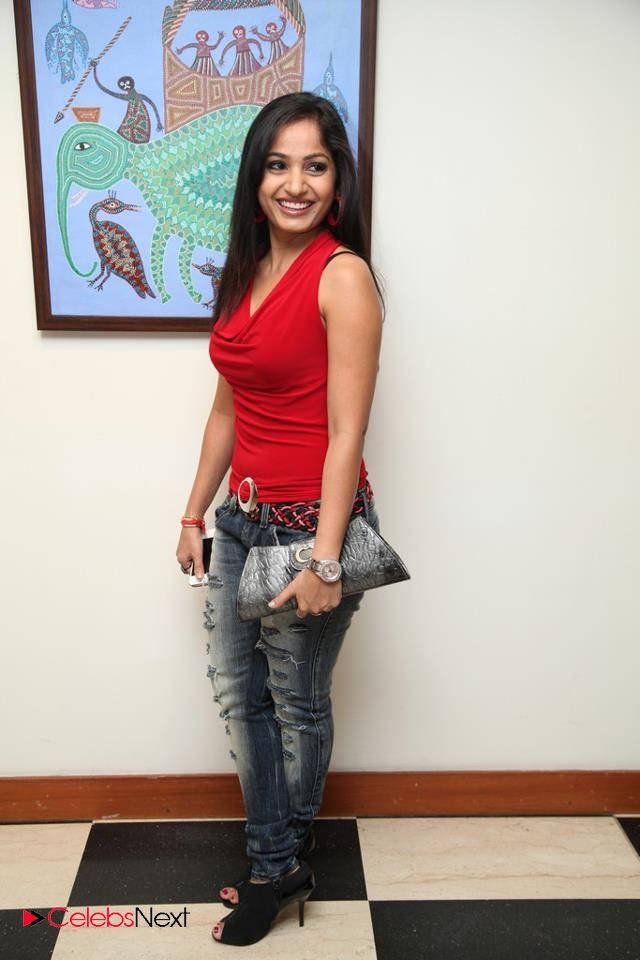 Madhavi Latha  Pictures in Red Sleeveless Top and Jeans at Muse Art Gallery  0010.jpg