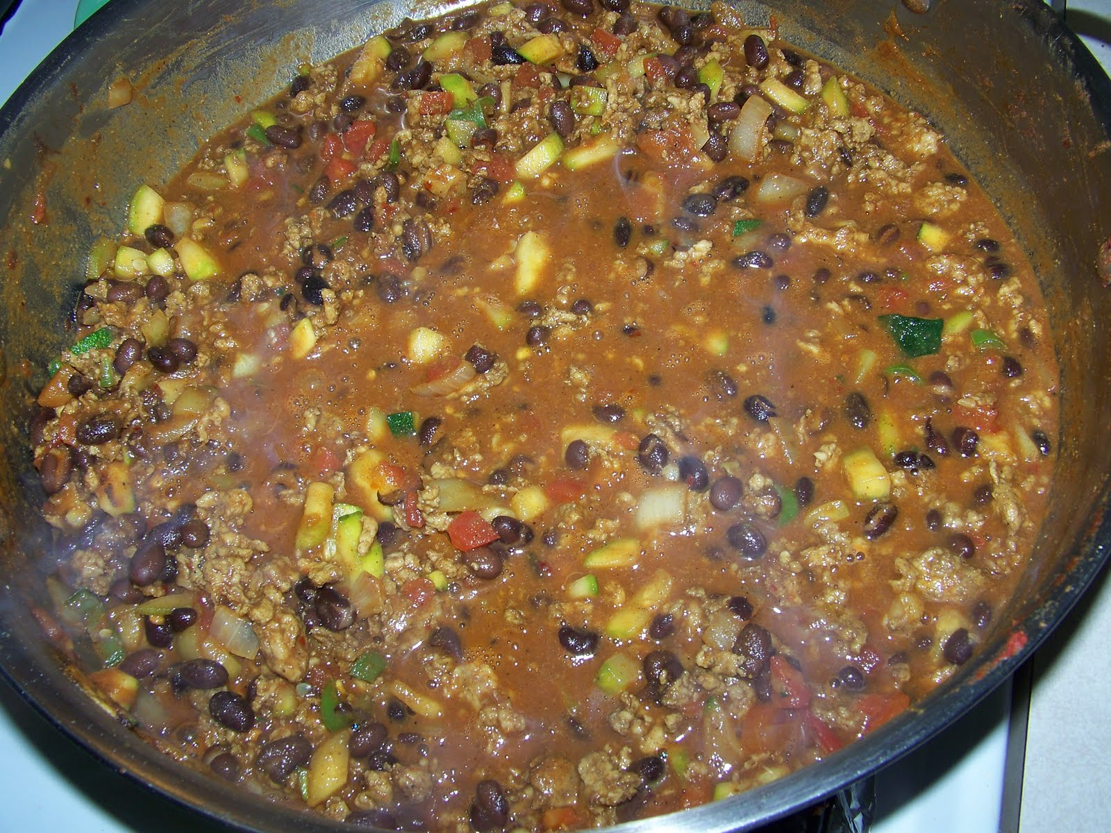 Kitchen simmer masala chili indian spiced chili fry until fragrant without burning about 1 minute then add the browned ground meat diced tomato and black beans with the water or chicken stock salt as forumfinder Choice Image