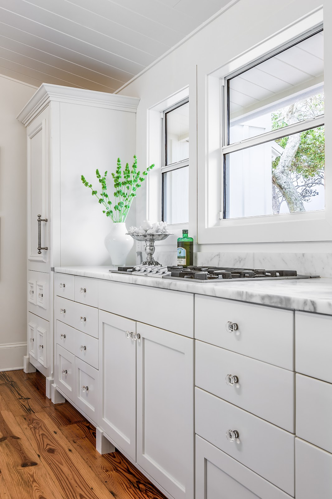 We Used Furniture Grade Custom Cabinets And A Gaggenau Cooktop Blends Into  The Statuary Marble.