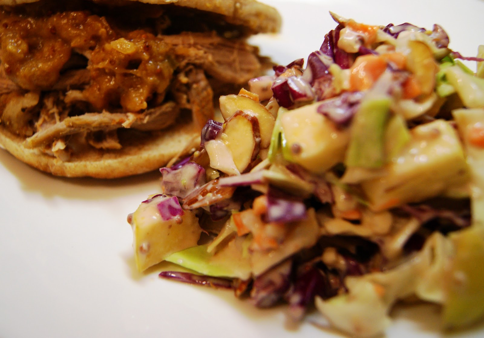 Shown served here with spicy peach barbecue pulled pork sandwich .