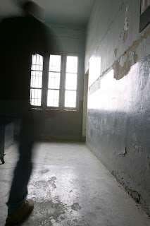 Blurred image of an inmate running through the halls of a prison.