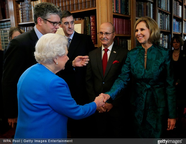 Queen Elizabeth II greets Lynn Forney Young, President of the Daughters of the American Revolution while attending the launch of the George III Project at an event held in the Royal Library in Windsor Castle