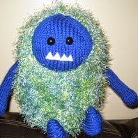 http://www.ravelry.com/patterns/library/fuzzy-monster