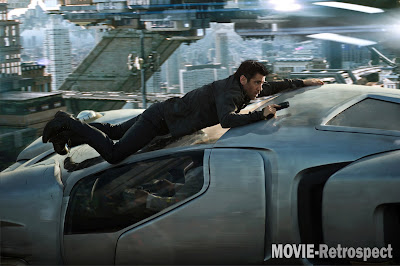 Colin Farrell clings to the front of a flying car in Total Recall