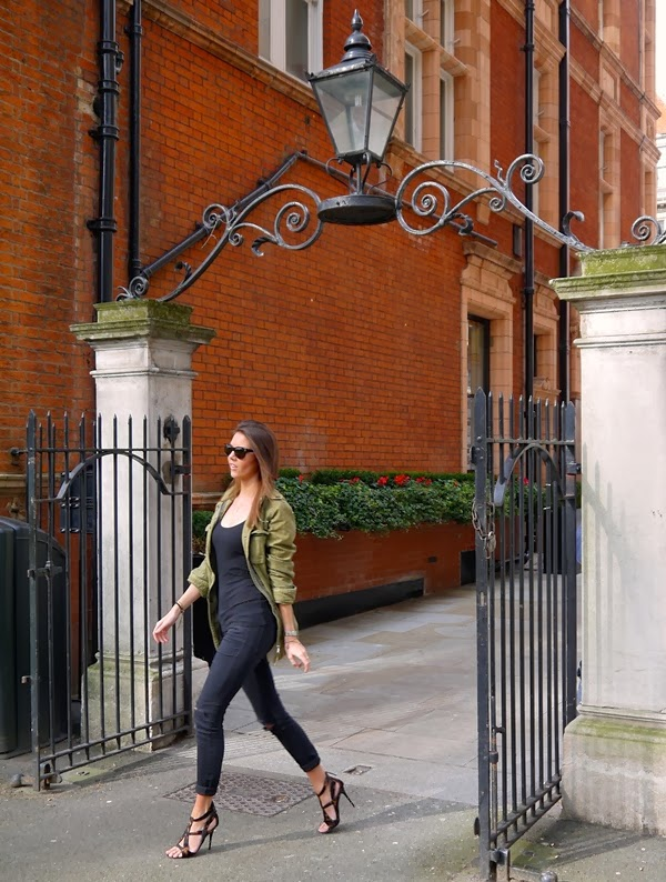Khaki parka and Giuseppe Zanotti heels in Mount Street Gardens, Mayfair