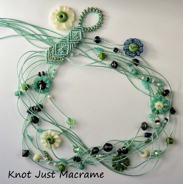 Multi-strand micro macrame necklace using lampwork by Jodie Marshall