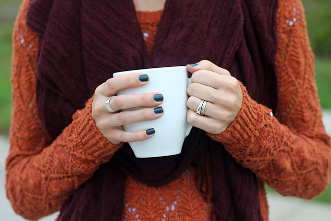 maroon scarf, orange sweater, hunter green nails