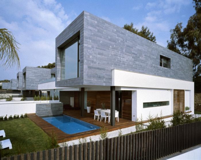 Hogares frescos 6 viviendas pareadas unidas por for Casas modernas unifamiliares