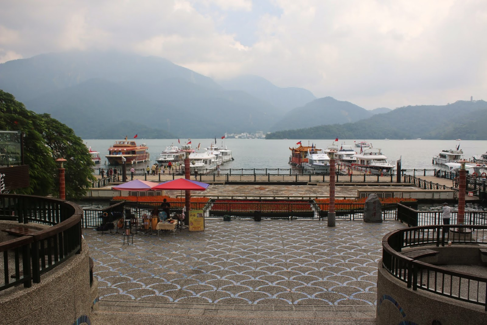 A close look at beautiful Sun Moon Lake and the greenery mountain from Shueishe Pier of Nantou County in Taiwan