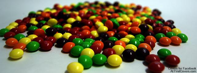 """<img src=""""http://4.bp.blogspot.com/-kIxXLXYrpug/UfR4XXZSrJI/AAAAAAAAC6o/6h1mjE8jagA/s1600/skittles-2446.jpg"""" alt=""""Colorful Facebook Covers"""" />"""