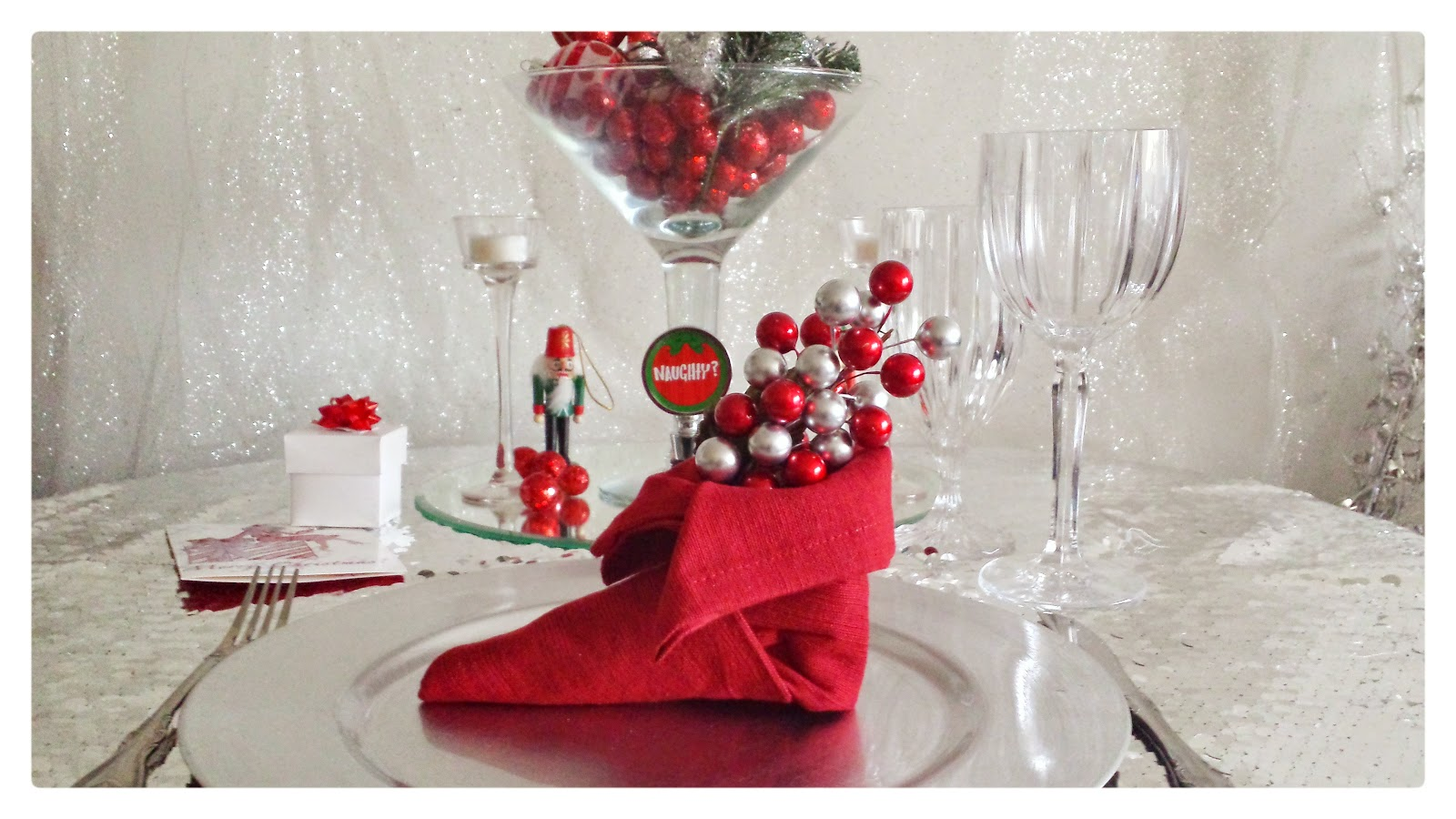 christmas table design for family party with gift box and naughty sign