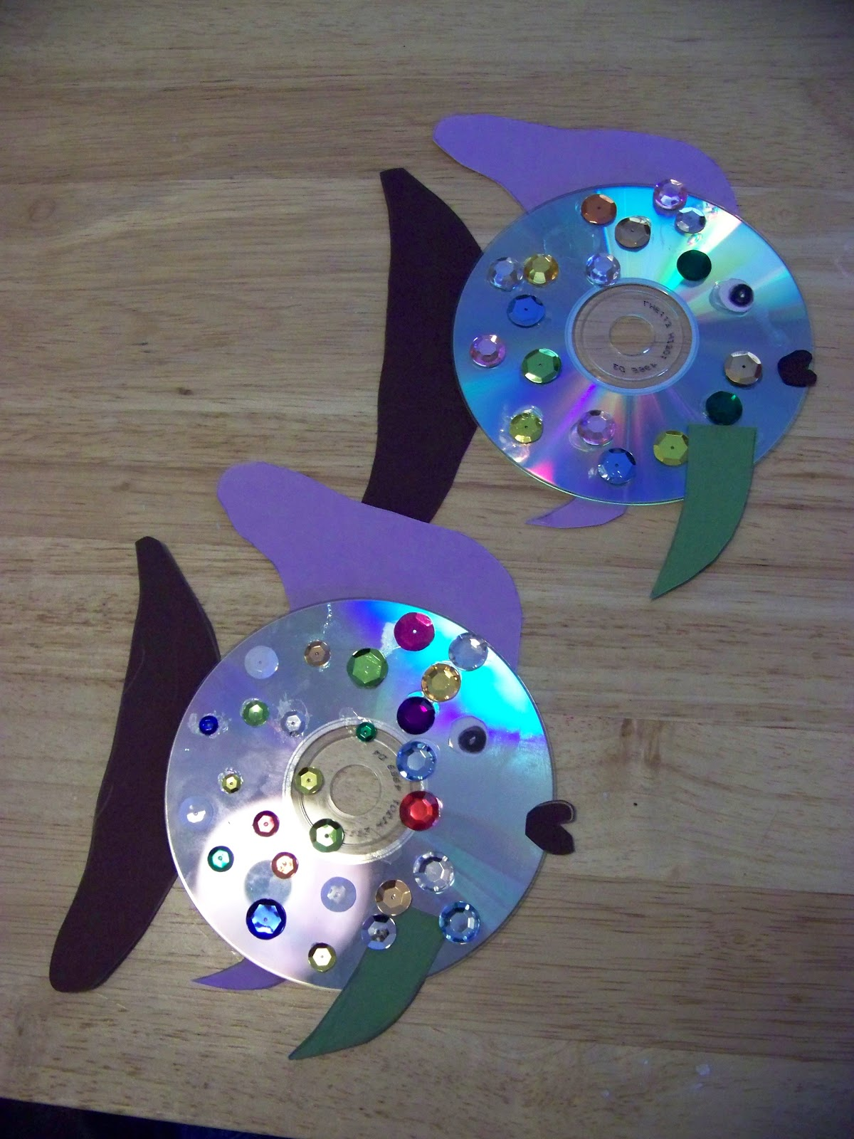 needed 1 cd construction paper craft glue sequins instructions