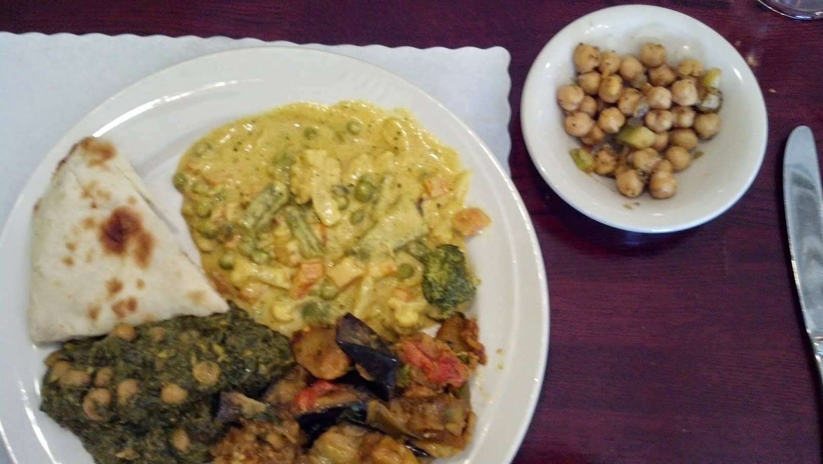 a vegetarian lunch was a pleasant option all my dishes were quite tasty they were rich with cream and moderately spiced but not hot - India Garden Blacksburg