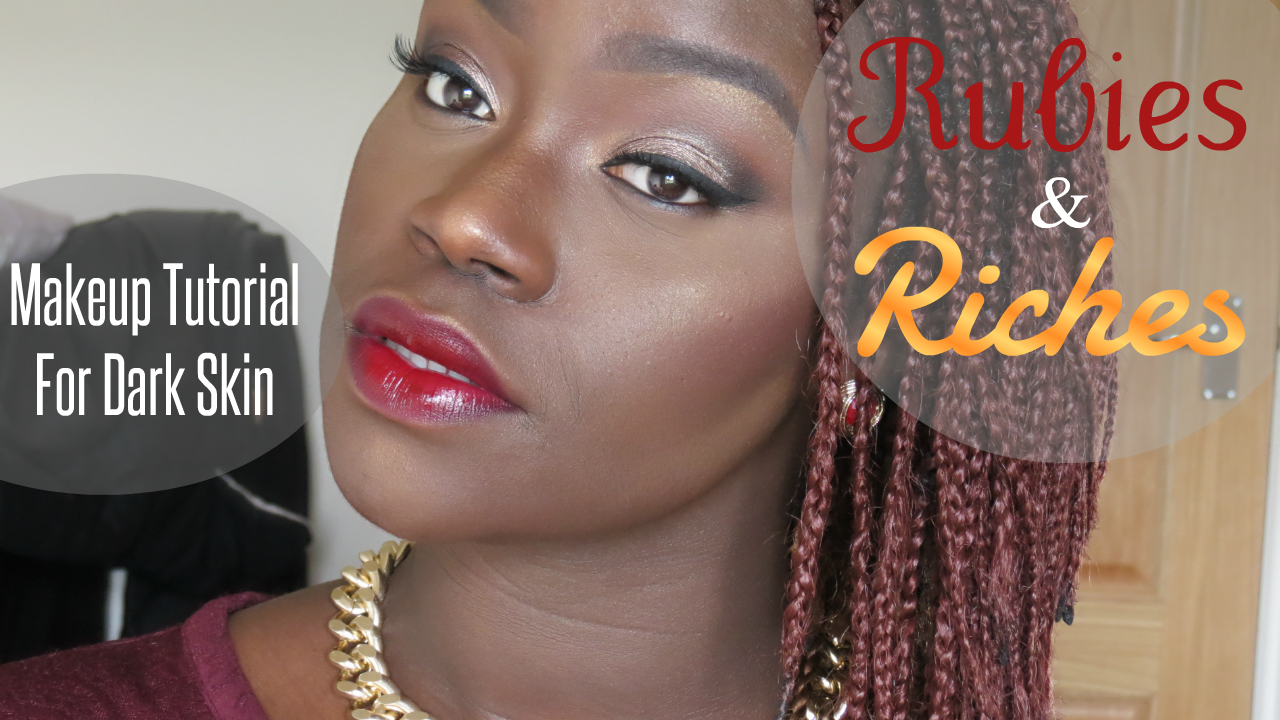 The metallic pop on the eyes and elegant ruby red lips are thanks to Freedom Makeup London.