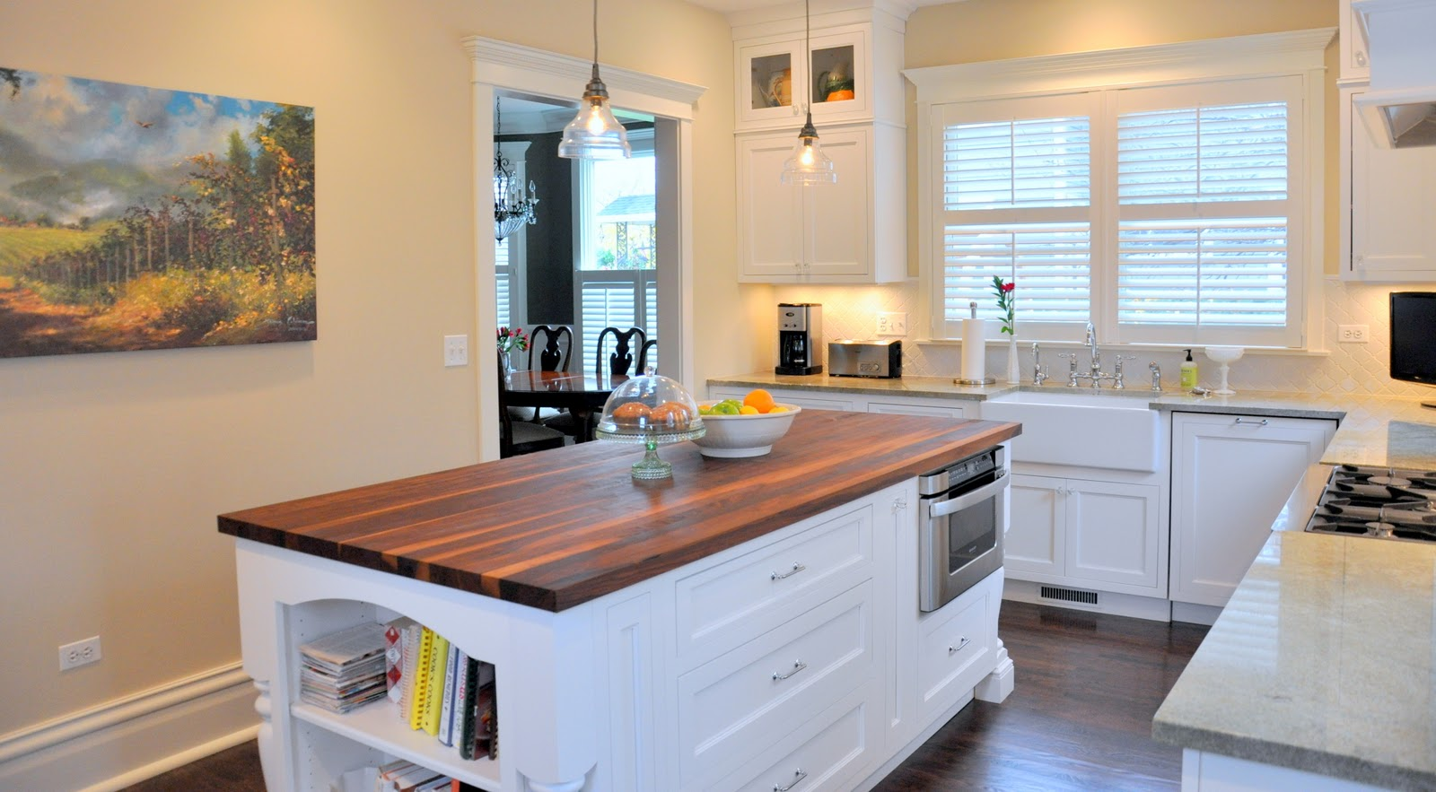 White Lshaped Kitchen with Island