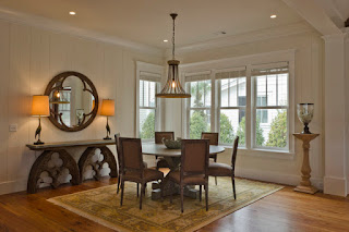 Rustic Dining Room with Round Dining Tables and Brown Chairs on Brown Carpet under Classic Iron Lamp