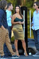 Kim Kardashian talking to the people at the car dealership