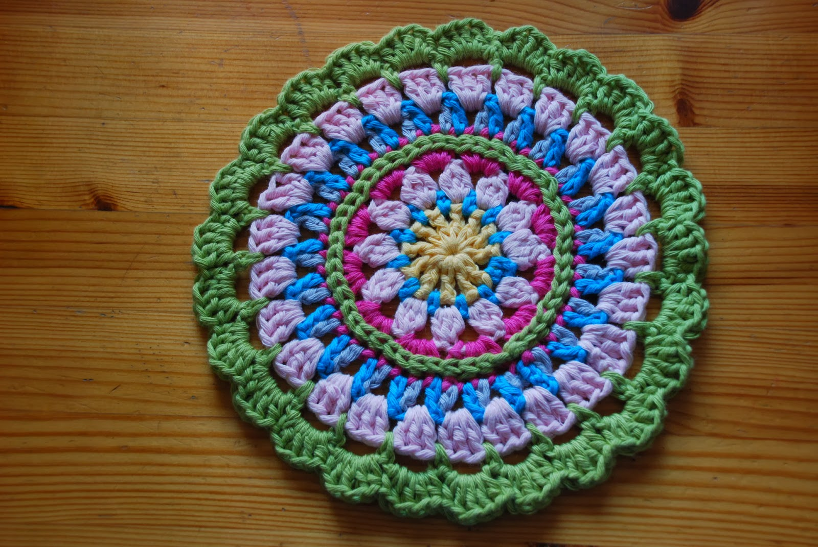 image of crocheted mandala in spring colours