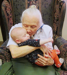 During the Play Date with Sisters program held at Saint Mary's Convent, Sister Estelle Marie, CSC, enjoys baby Emma. www.cscsisters.org