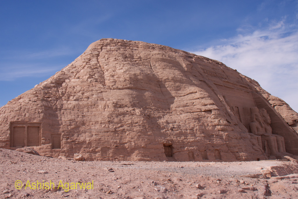 Side view of the hillock of Abu Simbel, including a view of the statues at the entrance